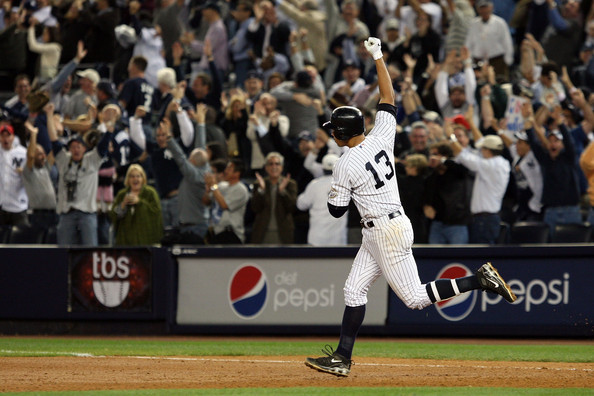 Alex Rodriguez #13 of the New York Yankees celebrates after hitting a two run home run in the ninth inning against the Minnesota Twins in Game Two of the ALDS during the 2009 MLB Playoffs at Yankee Stadium on October 9, 2009 in the Bronx borough of New York City.