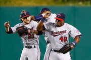 Torii Hunter #48, Shane Robinson #21, and Aaron Hicks #32 of the Minnesota Twins celebrate their win in center field against the Pittsburgh Pirates during the game at PNC Park on May 19, 2015 in Pittsburgh, Pennsylvania.