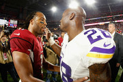 Adrian Peterson and Larry Fitzgerald Photos Photo
