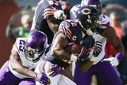Matt Forte #22 of the Chicago Bears carries the football against  Xavier Rhodes #29 of the Minnesota Vikings in the first quarter at Soldier Field on November 1, 2015 in Chicago, Illinois.