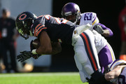 Matt Forte #22 of the Chicago Bears is grabbed at the feet as he gets hit by  Terence Newman #23 of the Minnesota Vikings in the second quarter at Soldier Field on November 1, 2015 in Chicago, Illinois.
