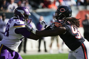 T.J. Clemmings #68 of the Minnesota Vikings blocks  Pernell McPhee #92 of the Chicago Bears in the first quarter at Soldier Field on November 1, 2015 in Chicago, Illinois.
