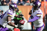 Quarterback Teddy Bridgewater #5 of the Minnesota Vikings hands the football off to Adrian Peterson #28 in the first quarter against the Chicago Bears at Soldier Field on November 1, 2015 in Chicago, Illinois.