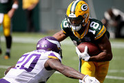 Randall Cobb #18 of the Green Bay Packers is tackled by Mackensie Alexander #20 of the Minnesota Vikings during the second quarter of a game at Lambeau Field on September 16, 2018 in Green Bay, Wisconsin.