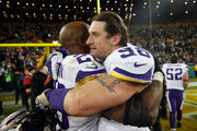 Adrian Peterson #28 of the Minnesota Vikings celebrates with Brian Robison #96 after defeating the Green Bay Packers with a score of 20 to 13 at Lambeau Field on January 3, 2016 in Green Bay, Wisconsin.