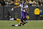 Michael Floyd #18 of the Minnesota Vikings is brought down by Josh Jones #27 of the Green Bay Packers during the second quarter of a game at Lambeau Field on December 23, 2017 in Green Bay, Wisconsin.