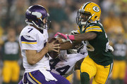 Casey Hayward #29 of the Green Bay Packers rushes quarterback  Christian Ponder #7 of the Minnesota Vikings at Lambeau Field on October 2, 2014 in Green Bay, Wisconsin. Packers defeat Vikings 42-10.