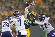 Luther Robinson #97 of the Green Bay Packers blocks the pass by quarterback  Christian Ponder #7 of the Minnesota Vikings in the second quarter of the NFL game at Lambeau Field on October 2, 2014 in Green Bay, Wisconsin.