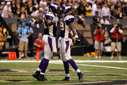 (L-R) Visanthe Shiancoe #81 and Adrian Peterson #28 of the Minnesota Vikings celebrate after Shiancoe scored a 20-yard touchdown reception in the second quarter against the New Orleans Saints at Louisiana Superdome on September 9, 2010 in New Orleans, Louisiana.