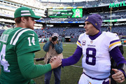 Sam Darnold #14 of the New York Jets and Kirk Cousins #8 of the Minnesota Vikings meet after the game at MetLife Stadium on October 21, 2018 in East Rutherford, New Jersey.
