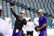 Trevor Siemian #3 (L) of the Minnesota Vikings throws the ball next to Kirk Cousins #8 before the game against the Philadelphia Eagles at Lincoln Financial Field on October 7, 2018 in Philadelphia, Pennsylvania.