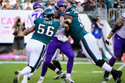 quarterback Kirk Cousins #8 of the Minnesota Vikings is tackled by defensive end Chris Long #56 and defensive tackle Destiny Vaeao #97 of the Philadelphia Eagles during the second quarter at Lincoln Financial Field on October 7, 2018 in Philadelphia, Pennsylvania.