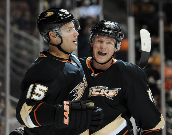 Ryan Getzlaf #15 of the Anaheim Ducks celebrates his goal with Corey Perry #10 for a 1-0 lead over the Minnesota Wild during the first period at Honda Center on December 4, 2011 in Anaheim, California.