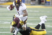 IOWA CITY, IOWA- OCTOBER 28: Running back Rodney Smith #1 of the Minnesota Golden Gophers is brought down in the second quarter by defensive end Matt Nelson #96 of the Iowa Hawkeyes on October 28, 2017 at Kinnick Stadium in Iowa City, Iowa.