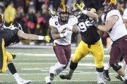 IOWA CITY, IOWA- OCTOBER 28:  Running back Rodney Smith #1 of the Minnesota Golden Gophers runs up the field in the second quarter in front of defensive lineman Nathan Bazata #99 of the Iowa Hawkeyes on October 28, 2017 at Kinnick Stadium in Iowa City, Iowa.
