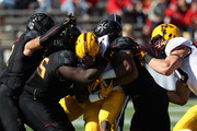 Rodney Smith #1 of the Minnesota Golden Gophers is gang tackled by the Maryland Terrapins defense in the first half at Capital One Field on October 15, 2016 in College Park, Maryland.