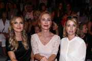 (L-R) Regina Halmich, Andrea Sawatzki and Tina Ruland attend the Minx by Eva Lutz show during the Mercedes-Benz Fashion Week Berlin Spring/Summer 2016 at Brandenburg Gate on July 8, 2015 in Berlin, Germany.
