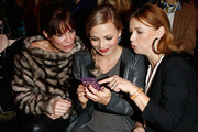 (L-R) Alexandra Kamp, Regina Halmich and Tina Ruland attend the Minx by Eva Lutz show during Mercedes-Benz Fashion Week Autumn/Winter 2014/15 at Brandenburg Gate on January 15, 2014 in Berlin, Germany.