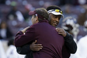 Head coach Kevin Sumlin of the Texas A&M Aggies meets with head coach Dan Mullen of the Mississippi State Bulldogs  prior to the game at Kyle Field on October 28, 2017 in College Station, Texas.