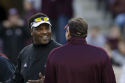 Head coach Kevin Sumlin of the Texas A&M Aggies talks with head coach Dan Mullen of the Mississippi State Bulldogs  before the game at Kyle Field on October 28, 2017 in College Station, Texas.
