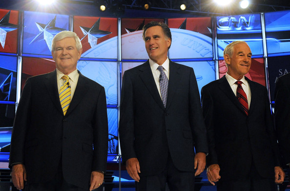 Ron Paul and Mitt Romney - Candidates Attend First GOP Primary Debate Of 2012 Presidential Race