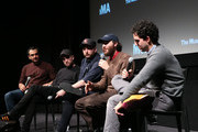 "(L-R) Moderator Ramin Setoodeh, Robert Pattinson, Daniel Lopatin, Joshua Safdie and Ben Safdie attend a Q&A for MoMA's Contenders Screening of ""Good Time"" at MoMA on December 1, 2017 in New York City."