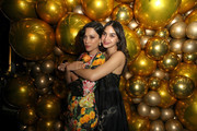 (L-R) Mishel Prada and Melissa Barrera join Moet & Chandon at the HFPA and The Hollywood Reporter's Celebration of the 2020 Golden Globe Ambassadors at Catch on November 14, 2019 in West Hollywood, California.