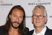 DJ Bob Sinclar and Moet & Chandon CEO Stephane Baschiera attend Moet & Chandon Celebrates Its 270th Anniversary With New Global Brand Ambassador, International Tennis Champion, Roger Federer at Chelsea Piers Sports Center on August 20, 2013 in New York City.