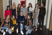 Spanish designer Moises Nieto (C) poses with friends during the presentation of the new collection of Moises Nieto during the Mercedes Benz Fashion Week Madrid at the Matador Club on January 27, 2018 in Madrid, Spain.