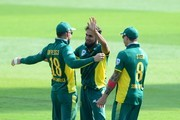 Imran Tahir of the Proteas celebrates the wicket of Travis Head of Australia with his team mates  during the 1st Momentum ODI Series match between South Africa and Australia at SuperSport Park on September 30, 2016 in Pretoria, South Africa.