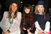 Anna Dello Russo, Miroslava Duma and Irene Kim attend the Moncler Gamme Rouge show as part of the Paris Fashion Week Womenswear Fall/Winter 2015/2016 on March 11, 2015 in Paris, France.