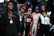 Migos meets with Austin Dillon, driver of the #3 Dow Coating Chevrolet, and Darrell Wallace Jr., driver of the #43 Farmer John Chevrolet, prior to the start of the Monster Energy NASCAR Cup Series Auto Club 400 at Auto Club Speedway on March 18, 2018 in Fontana, California.