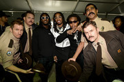 The cast of Super Troopers 2 and Migos pose for a photo prior to the Monster Energy NASCAR Cup Series Auto Club 400 at Auto Club Speedway on March 18, 2018 in Fontana, California.