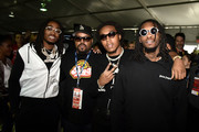 Ice Cube and Migos pose for a photo prior to the Monster Energy NASCAR Cup Series Auto Club 400 at Auto Club Speedway on March 18, 2018 in Fontana, California.
