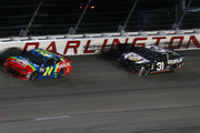 William Byron, driver of the #24 AXALTA Throwback Chevrolet, leads Ryan Newman, driver of the #31 Caterpillar Chevrolet, during the Monster Energy NASCAR Cup Series Bojangles' Southern 500 at Darlington Raceway on September 2, 2018 in Darlington, South Carolina.