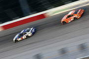 Kevin Harvick, driver of the #4 Busch Beer Throwback Ford, leads Daniel Suarez, driver of the #19 ARRIS Toyota,  during the Monster Energy NASCAR Cup Series Bojangles' Southern 500 at Darlington Raceway on September 2, 2018 in Darlington, South Carolina.