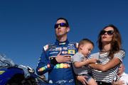 Kyle Busch, driver of the #18 M&M's Caramel Toyota, wife Samantha Busch and their son Brexton take part in pre-race ceremonies for the Monster Energy NASCAR Cup Series Championship Ford EcoBoost 400 at Homestead-Miami Speedway on November 19, 2017 in Homestead, Florida.