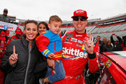Kyle Busch, driver of the #18 Skittles Toyota, poses with his wife, Samantha, and his son, Brexton, after winning the rain delayed  Monster Energy NASCAR Cup Series Food City 500 at Bristol Motor Speedway on April 16, 2018 in Bristol, Tennessee.