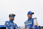 Ricky Stenhouse Jr., driver of the #17 Fastenal Ford, and Chris Buescher, driver of the #37 Kroger ClickList Chevrolet, stand on the grid prior to the Monster Energy NASCAR Cup Series Foxwoods Resort Casino 301 at New Hampshire Motor Speedway on July 22, 2018 in Loudon, New Hampshire.