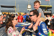 Kyle Busch, driver of the #18 M&M's Caramel Toyota, spends a moment with son Brexton and wife Samantha on the grid prior to the Monster Energy NASCAR Cup Series KC Masterpiece 400 at Kansas Speedway on May 12, 2018 in Kansas City, Kansas.