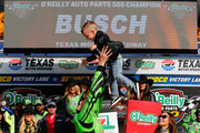 Kyle Busch, driver of the #18 Interstate Batteries Toyota, celebrates in Victory Lane with his son Brexton and wife Samantha after winning the Monster Energy NASCAR Cup Series O'Reilly Auto Parts 500 at Texas Motor Speedway on April 8, 2018 in Fort Worth, Texas.
