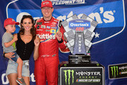 Kyle Busch, driver of the #18 Skittles Red White & Blue Toyota, poses with his wife, Samantha, and their son, Brexton, after winning the Monster Energy NASCAR Cup Series Overton's 400 at Chicagoland Speedway on July 1, 2018 in Joliet, Illinois.