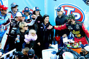 Clint Bowyer, driver of the #14 Haas Automation Demo Day Ford, is congratulated in Victory Lane by Martin Truex Jr., driver of the #78 5-hour ENERGY/Bass Pro Shops Toyota, after winning the weather delayed Monster Energy NASCAR Cup Series STP 500 at Martinsville Speedway on March 26, 2018 in Martinsville, Virginia.