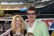 Alex McCord of Real Housewives of NYC and her husband Simon van Kempen and family attend the Monster Energy SuperCross World Championship Race at MetLife Stadium on April 26, 2014 in East Rutherford, New Jersey.