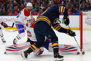 Antti Niemi #37 of the Montreal Canadiens makes the save against Ryan O'Reilly #90 of the Buffalo Sabres during the second period at KeyBank Center on March 23, 2018 in Buffalo, New York.