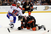 Andrew Cogliano #7 of the Anaheim Ducks lunges for a loose puck as Andrei Markov #79 of the Montreal Canadiens defends during the third period of a game at Honda Center on November 29, 2016 in Anaheim, California.