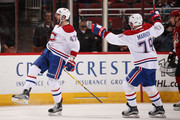 Alexander Radulov #47 (L) of the Montreal Canadiens celebrates with Andrei Markov #79  after scoring a goal against the Arizona Coyotes during the third period of the NHL game at Gila River Arena on February 9, 2017 in Glendale, Arizona. The Canadiens defeated the Coyotes 5-4 in overtime.