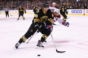David Pastrnak #88 of the Boston Bruins carries the puck with pressure from Andrei Markov #79 of the Montreal Canadiens during the first period at TD Garden on February 8, 2015 in Boston, Massachusetts.