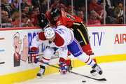 David Jones #19 of the Calgary Flames checks Andrei Markov #79 of the Montreal Canadiens during an NHL game at Scotiabank Saddledome on October 30, 2015 in Calgary, Alberta, Canada.
