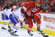 Andrei Markov #79 of the Montreal Canadiens attempts to move Manny Malhotra #22 of the Carolina Hurricanes off of the puck during a game at PNC Arena on February 8, 2014 in Raleigh, North Carolina.